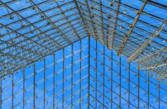 The pyramid grid roof of the Louvre in Paris, France stock image