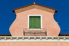 Roof with green window of old Italian house on Murano Island in Venice Stock Photos