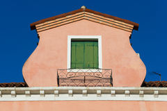Roof with green window of old italian house on Murano Island Royalty Free Stock Images