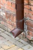 Roof gutter downspout drain pipe on facade house.  stock images