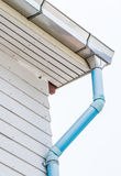 Roof gutter with the drainpipe. Royalty Free Stock Photo