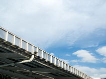 Roof gutter of factory. Against blue sky Royalty Free Stock Image