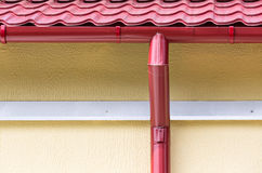 Roof gutter. New metal tiled roof and gutter Royalty Free Stock Photos