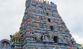 Hindu Temple with a fine ornate detailed roof. The roof of a Hindu temple with many detailed figures and ornaments, beautiful colors with the various Hindu gods royalty free stock image