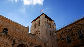 Roof of the Holy Sepulcher Church in Jerusalem. With flying flag. The Holy Sepulchre Church and Empty Tomb the most sacred places for all religious Christians Royalty Free Stock Photography