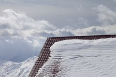Roof of hotel in snow and winter mountains Stock Photo
