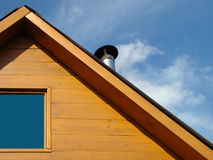 Roof of house. With a pipe and window on a background sky Royalty Free Stock Photos