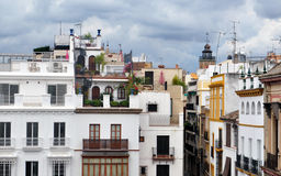 Roof of house. Facades of old houses in various colors lying About the other side in the Spanish city of Seville Stock Photo