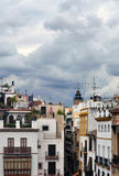 Roof of house. Facades of old houses in various colors lying About the other side in the Spanish city of Seville Stock Image
