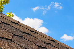 The roof of the house in the background of the sky Royalty Free Stock Photo