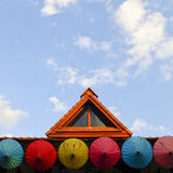 Roof house with colorful umbrella Royalty Free Stock Image