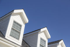 Roof of House and Dormer Windows Against Deep Blue Sky Stock Image
