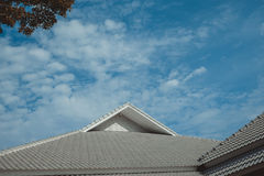 Roof of the house with green tree, blue sky and cloud in vintage. Roof of the house with green tree, blue sky and cloud. building with nature background in Royalty Free Stock Photography