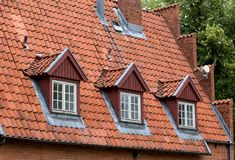 The roof of the house with nice window.  stock image