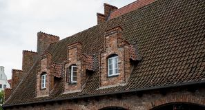 The roof of the house with nice window.  royalty free stock images