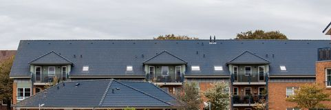 The roof of the house with nice window.  royalty free stock photo