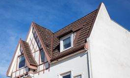 The roof of the house with nice window.  stock photos