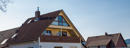 The roof of the house with nice window.  royalty free stock image