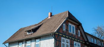 The roof of the house with nice window.  stock photography