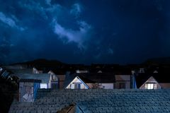 Roof of house at night with houses on background Royalty Free Stock Photo