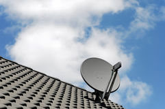 Roof of house with satellite dish Royalty Free Stock Photography