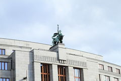 Roof of house with statue Stock Photos