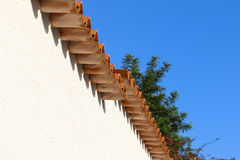 Roof of the house. Roof  tiles from houses on blue background Royalty Free Stock Image