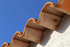 Roof of the house. Roof  tiles from houses on blue background Stock Images