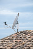 Roof of a house with tiles and satellite dish Royalty Free Stock Photography