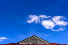 Roof of house under the blue sky. Stock Photos