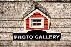 Roof of a house with window and a sign Stock Image