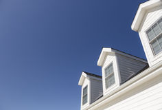 Roof of House and Windows Against Deep Blue Sky Stock Photos