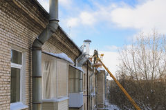 Roof icicle removal Stock Images