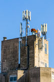 Roof of industrial building with GSM antennas Royalty Free Stock Photos