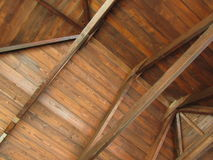 Roof inside the house made of wood. En boards, bottom view royalty free stock photos