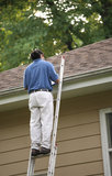 Roof Inspection Being Performed. A man who could be an insurance adjuster , home inspector or roofing estimator performing a roofing inspection Royalty Free Stock Images