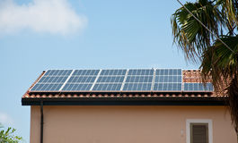 Roof- installed solar panels that are used to make electricity Stock Image