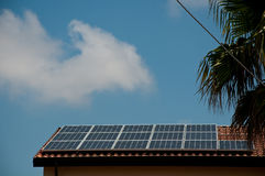 Roof- installed solar panels that are used to make electricity Royalty Free Stock Image
