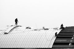 Roof Installer in black and white. Metal Sheet Roof Installer in black and white Royalty Free Stock Photography