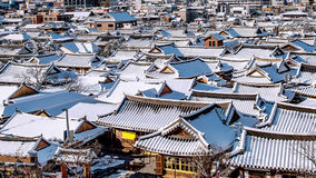 Roof of Jeonju traditional Korean village covered with snow, Jeonju Hanok village in winter, Korea.
