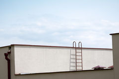 Roof with a ladder Stock Image
