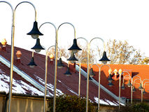 Roof and lamps. Red roof and stainless steel street lamps Stock Image