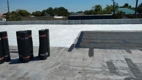 roof leak repairs on Commercial flat roof; roofing Royalty Free Stock Images