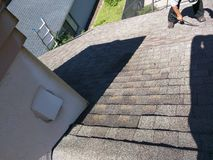 Roof leak repairs on residential shingle in process Royalty Free Stock Photography