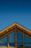 Roof of Log Cabin on Blue Sky Stock Image