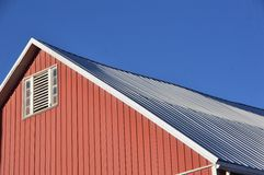 Roof. Metal roof on a barn with small window stock photo