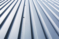 Roof metal sheet. Close-up of a grey metal sheet part of a roof royalty free stock photo