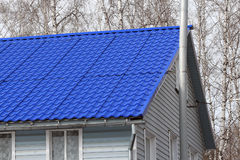 Roof with metal tile Stock Photos