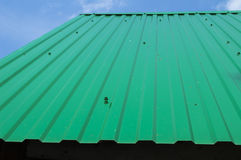 Roof. The roof from a metal tile of green color Stock Images