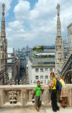 The roof of Milan Cathedra (Italy) and family. Royalty Free Stock Image